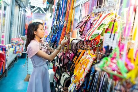 woman picking something in shop