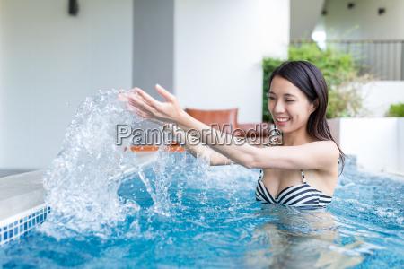 asian woman enjoy jacuzzi in resort
