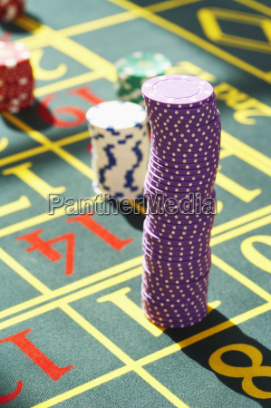 gambling chips on roulette table close