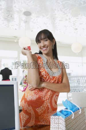 woman with credit card at counter