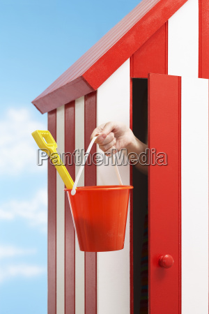 woman with bucket and spade in