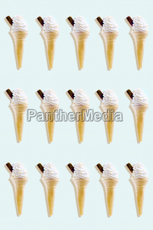 rows of icecreams on colored background