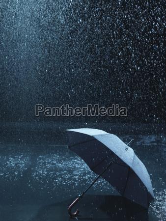 unused umbrella lying on ground being