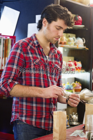 young man working in teahouse