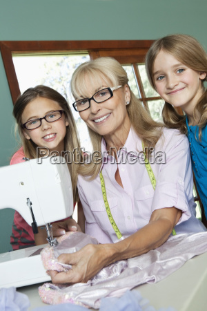 portrait of happy granddaughters with grandmother