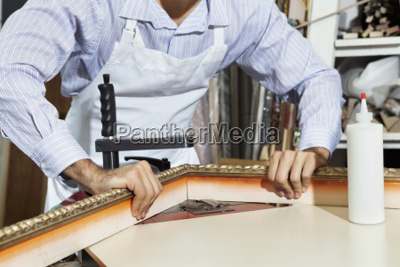 midsection of a young craftsman working