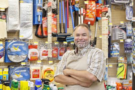 portrait of a happy mature salesperson