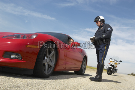 traffic cop talking with driver of