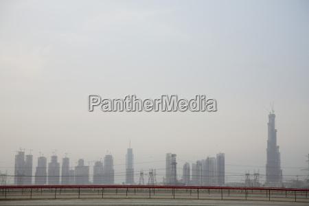 dubaiAEos skyline from racetrack