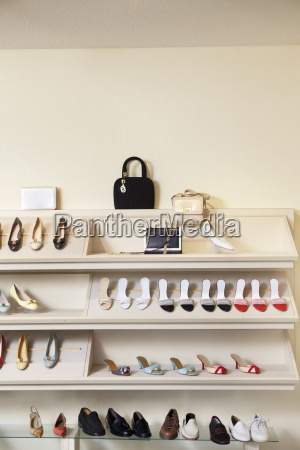 footwear on display rack in shoe