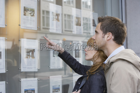 couple looking at display at real