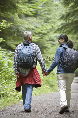 couple walking on forest road