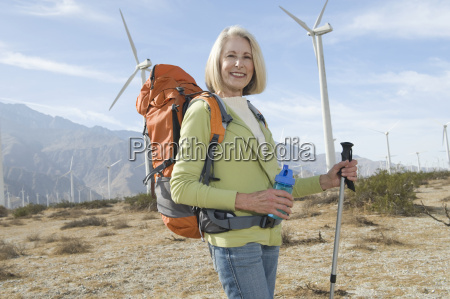 senior woman with hiking pole and