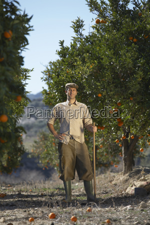 farmer standing in orange field