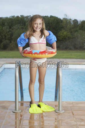 smiling girl with inflatable ring and