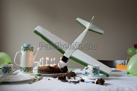 model airplane into birthday cake