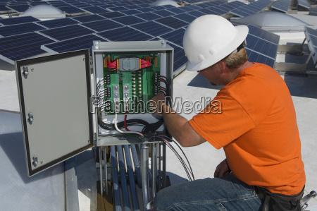 electrical engineer repairing electricity box