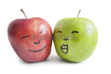red and green apples with face