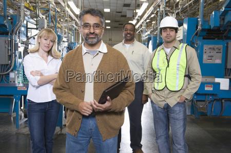 multiethnic operators in newspaper factory