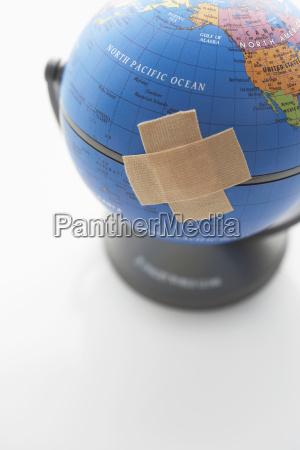 adhesive bandage on globe