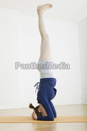 woman performing headstand