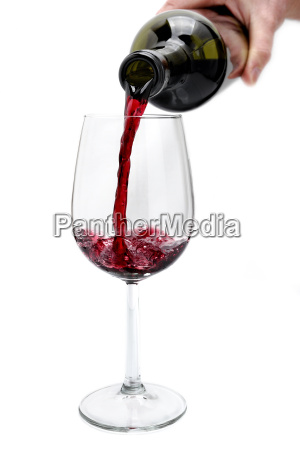 red wine poured from a bottle