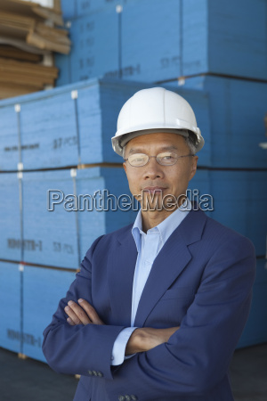 portrait of manager wearing hard hat