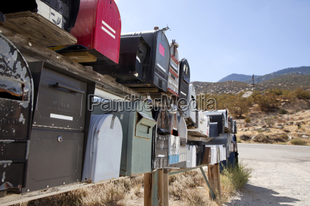 rows of mailboxes by dusty road