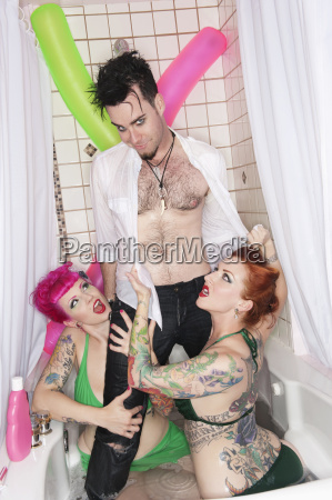 man standing in bathtub with women