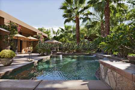 luxury villa with waterfall feature and