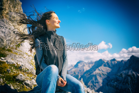 woman on mountain hike resting her