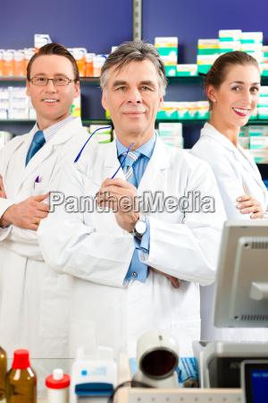 team of pharmacists in pharmacy