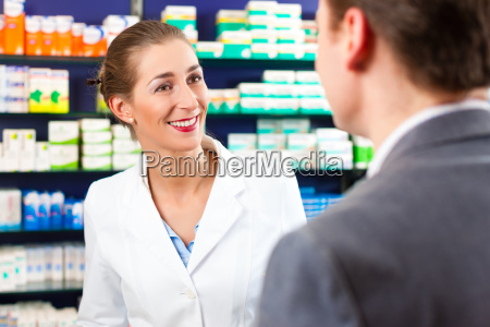 female pharmacist consulting a customer in