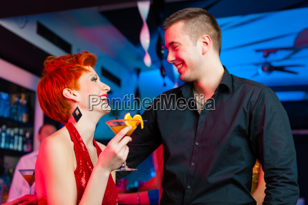 young couple in bar or club