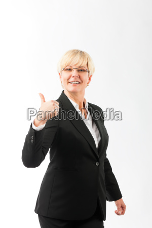 mature woman with thumbs up