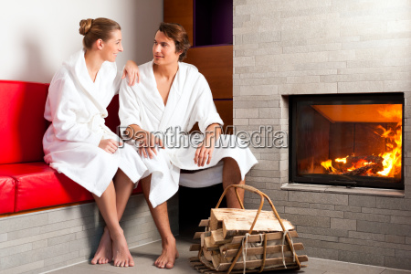 young couple sitting in bathrobe for
