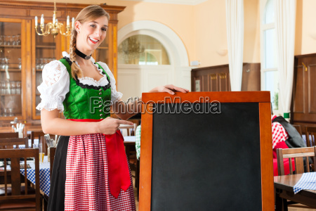 female innkeeper in traditional bavarian clothes