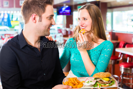 friends or couple eating fast food