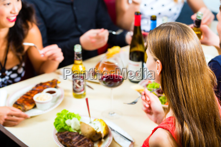 friends eating and drinking in fast