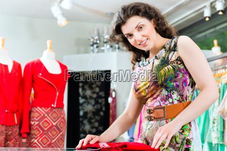 young woman shopping in fashion department