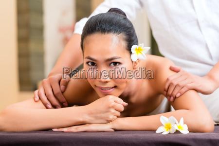 indonesian woman wellness massage in spa