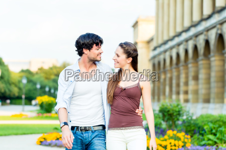 tourist couple in city walking