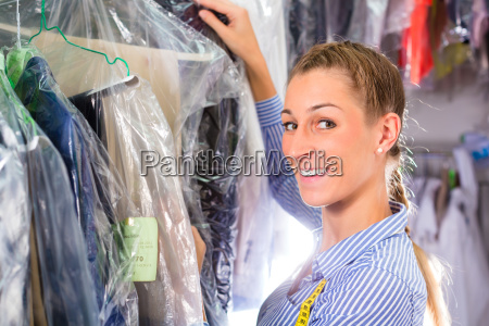 cleaner in laundry shop checking clean