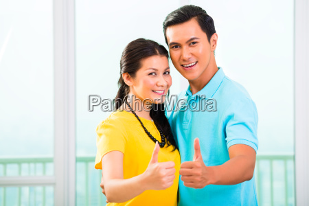 young asian couple in apartment with