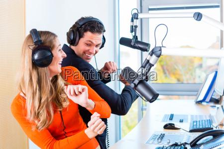 radio presenters in radio station on