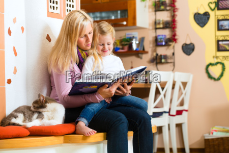 mother reading night story to kid