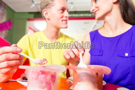 couple eating ice cream in cafe