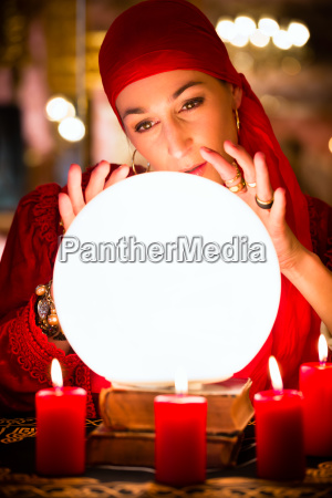 fortuneteller at seance or session with