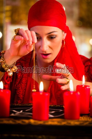 fortuneteller during pendulum session