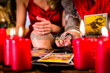 fortuneteller laying tarot cards with client